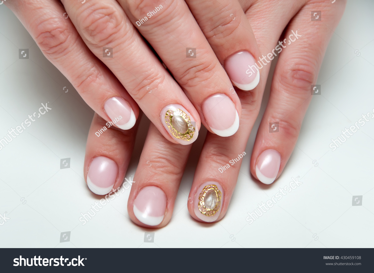 wedding french manicure with liquid stone cameo brooch on the ring ...