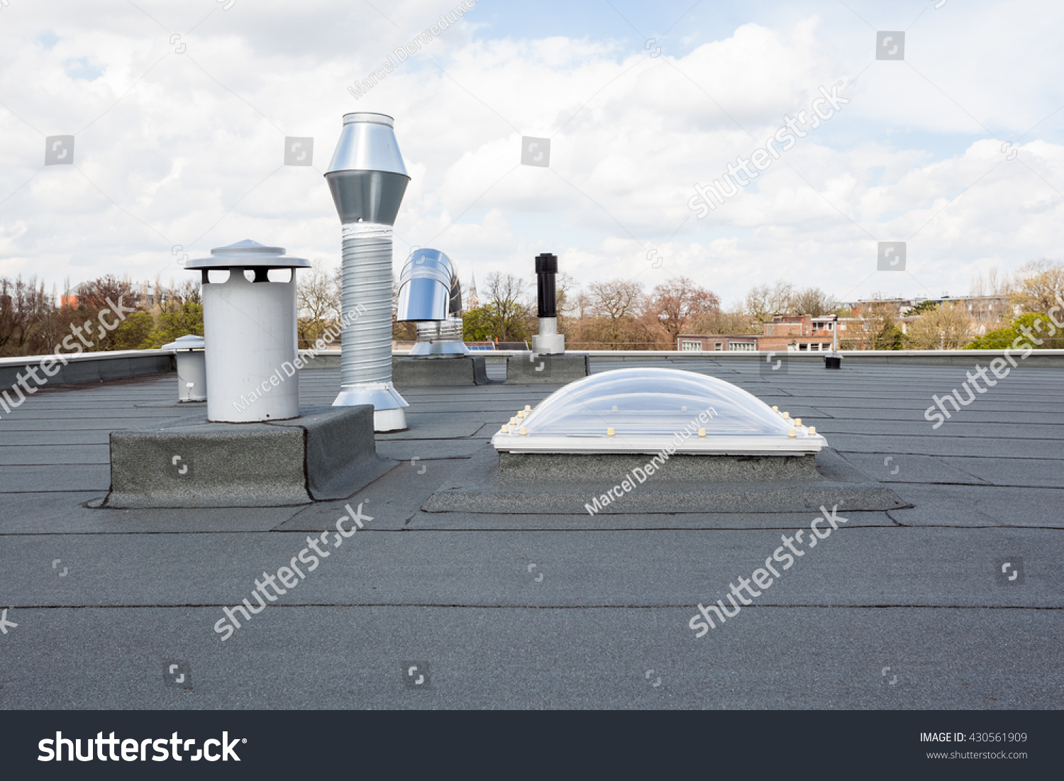 inox chimney on the flat roof in the city stock photo. Black Bedroom Furniture Sets. Home Design Ideas