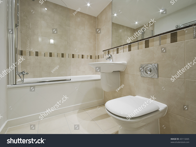 Modern bathroom detail white suite floor stock photo 43113265 modern bathroom detail with white suite and floor to ceiling tiles dailygadgetfo Gallery