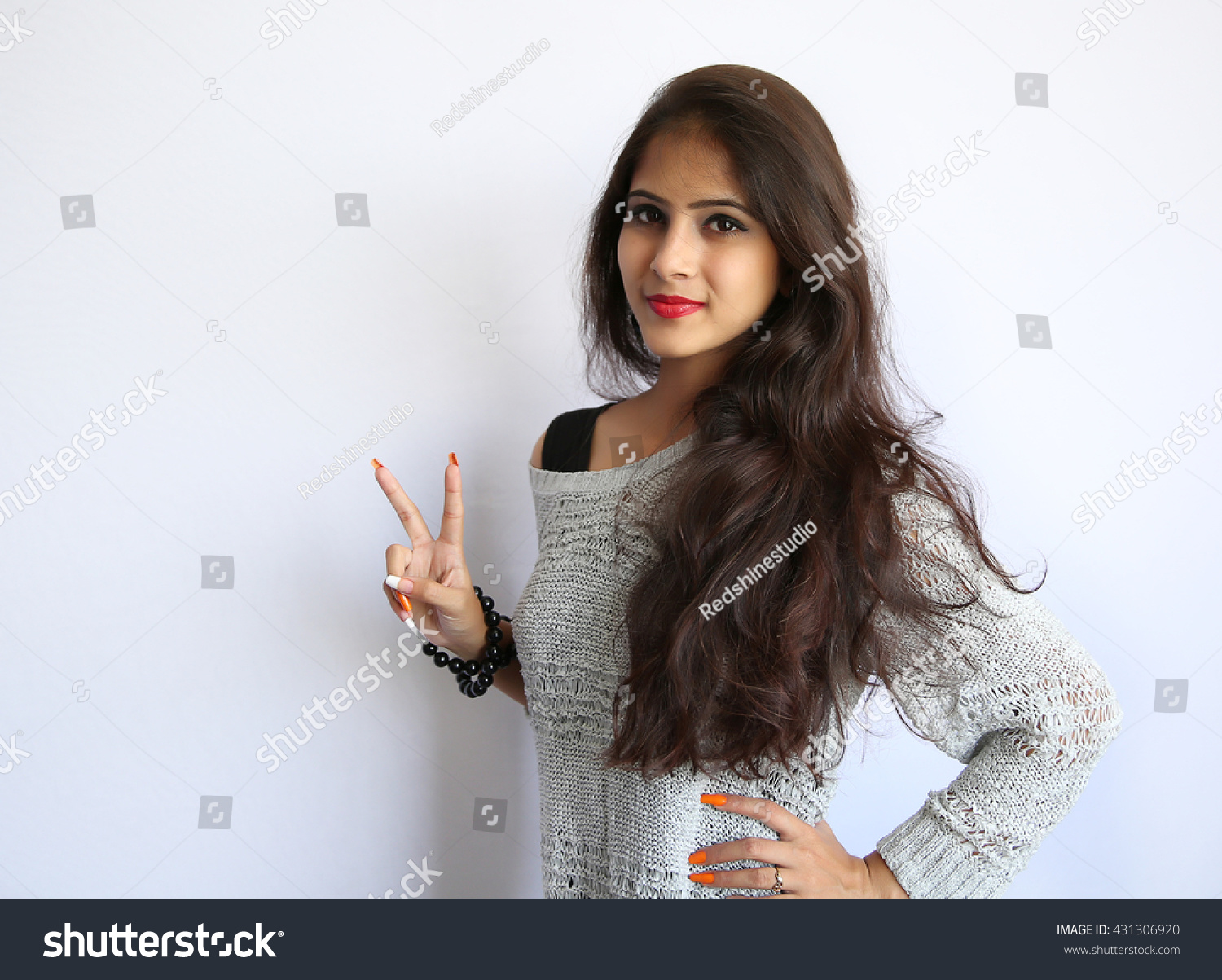 Young Beautiful Indian Girl Raising Two Stock Photo Edit Now