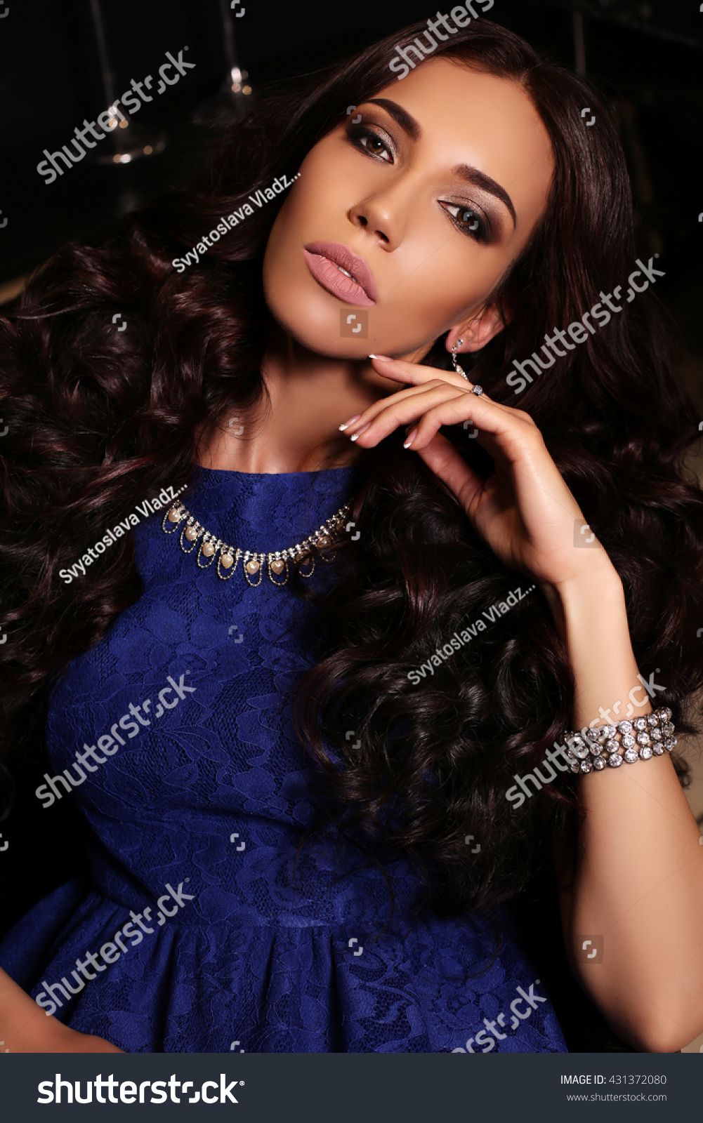 7b28e0bee7e fashion interior photo of gorgeous woman with long dark hair in luxurious  dress with accessories