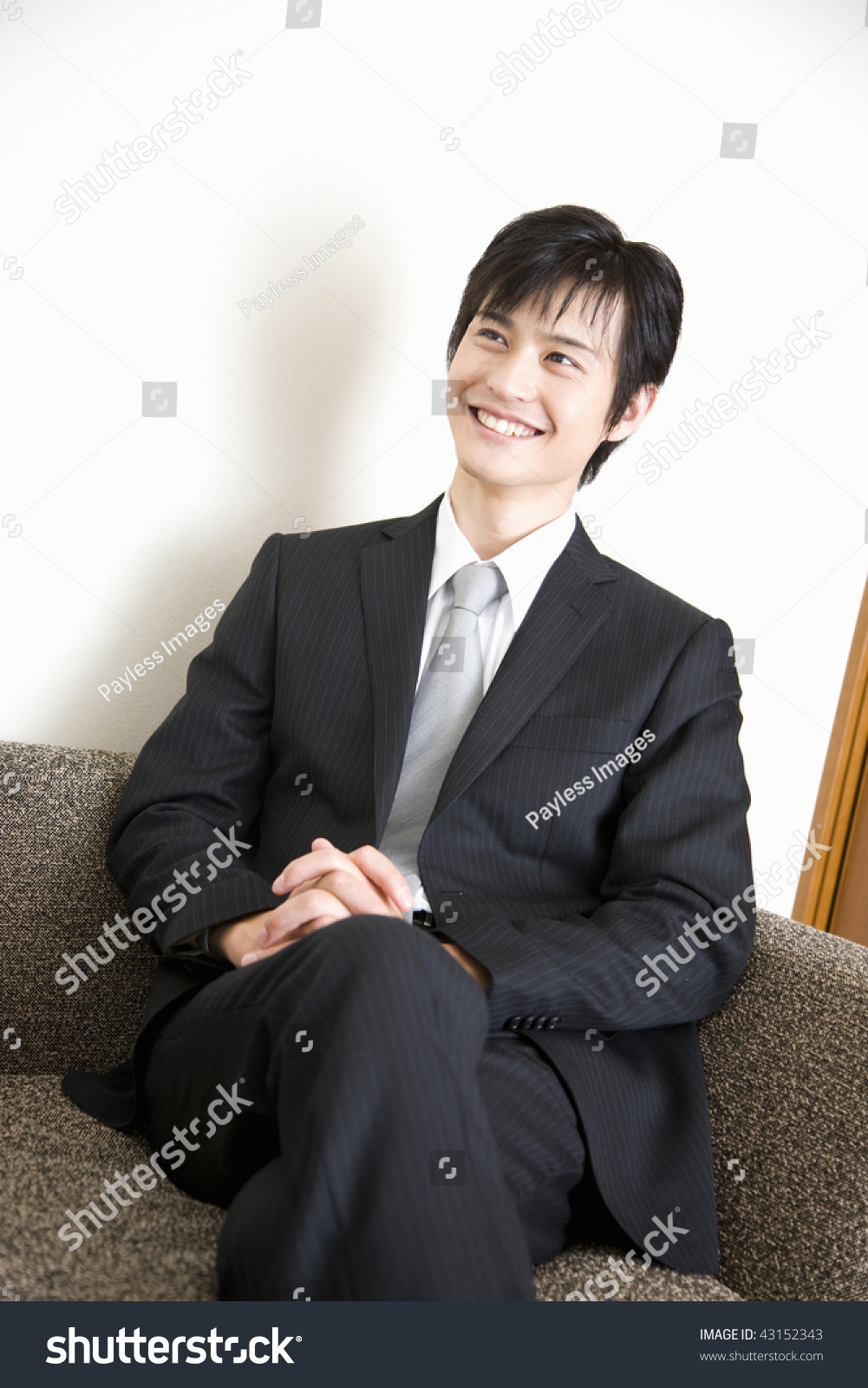 Young Japanese Businessman Wearing Suit Is Smiling Stock Photo ...