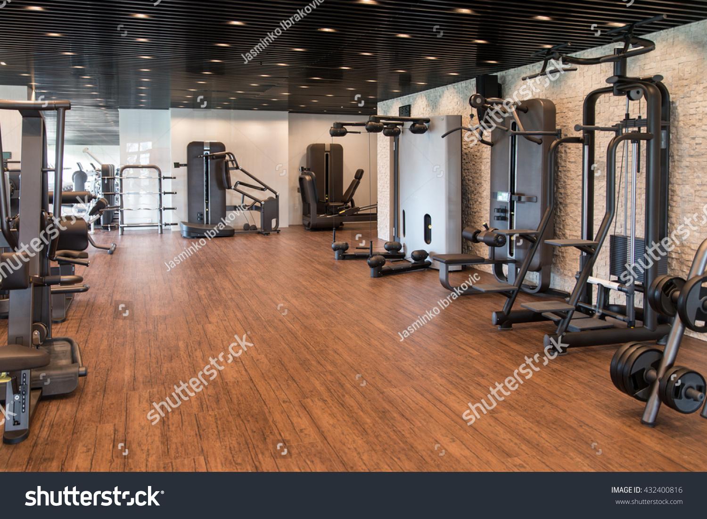Equipment machines modern gym room fitness stock photo