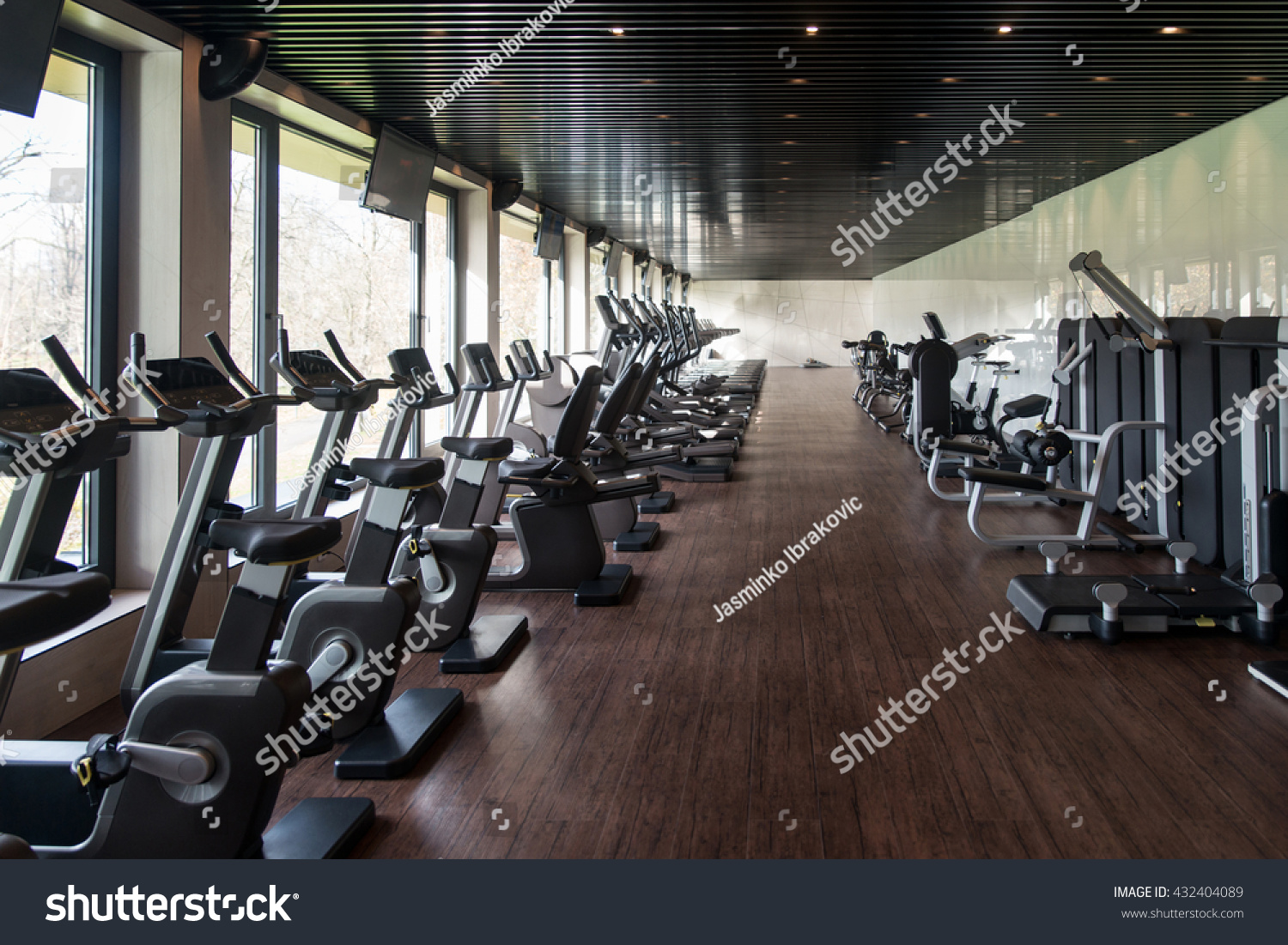Equipment machines modern gym room fitness stock photo