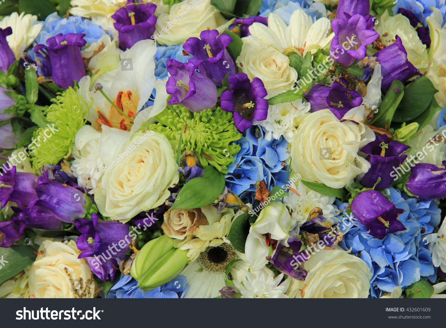 blue hydrangea and purple roses in a blue purple wedding bouquet and centerpieces ez canvas
