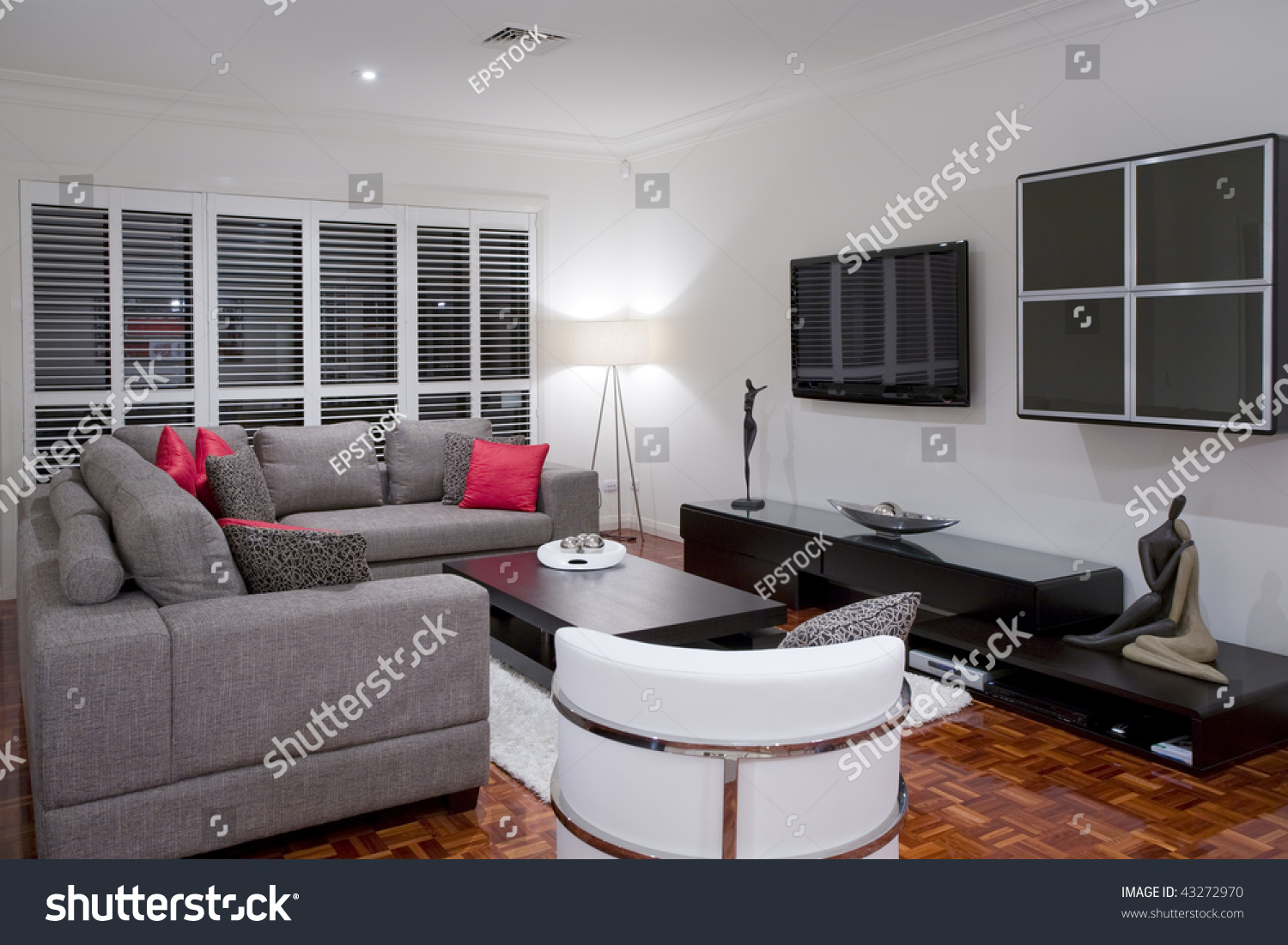 Modern living room interior with charcoal sofa and chocolate brown coffee table and wide screen for Charcoal and brown living room