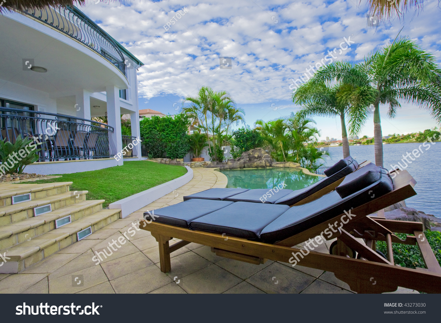 Deck Chairs By The Pool At Waterfront Mansion Stock Photo 43273030 Shutterstock