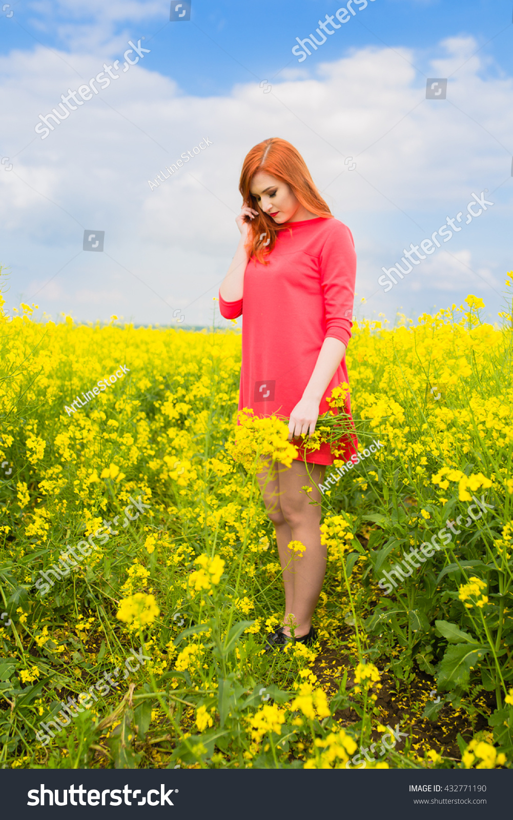 Happy Young Girl Standing On Spring Field Of Yellow Flowers Rape