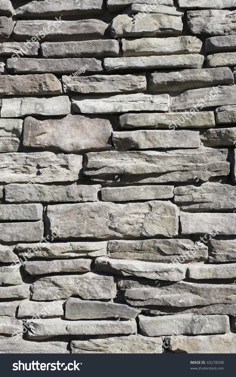 Detail Stone Slabs : Closeup detail of a gray slab stone wall stock photo