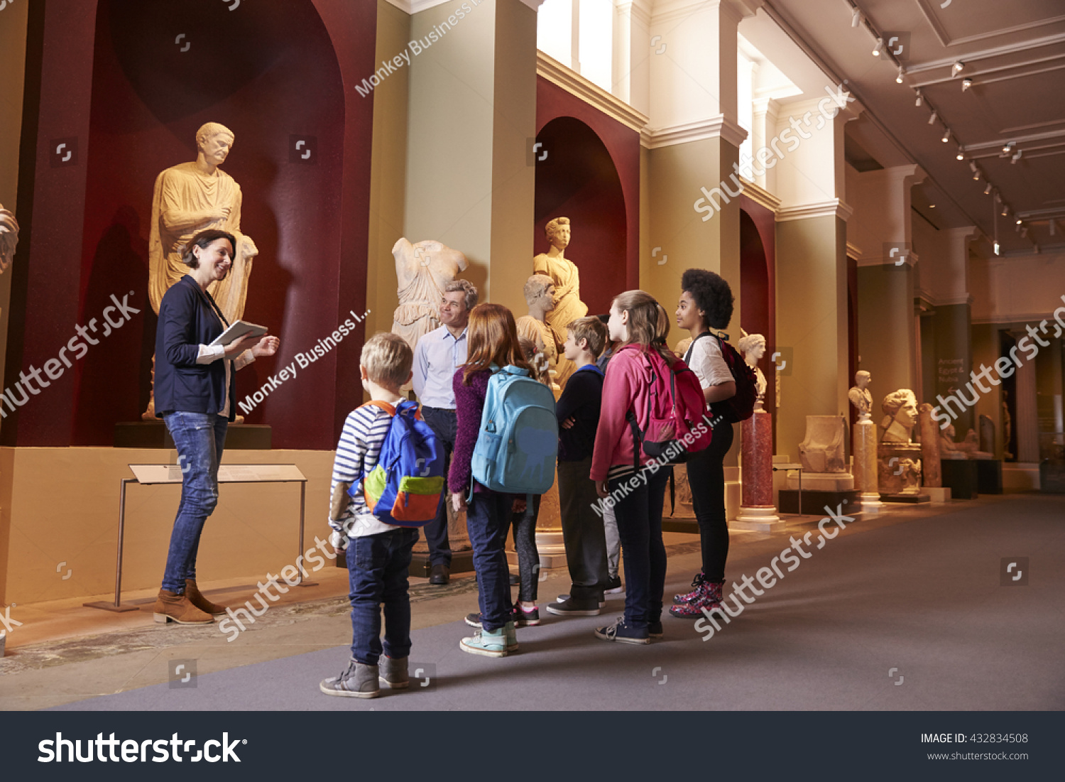 Pupils And Teacher On School Field Trip To Museum With Guide #432834508