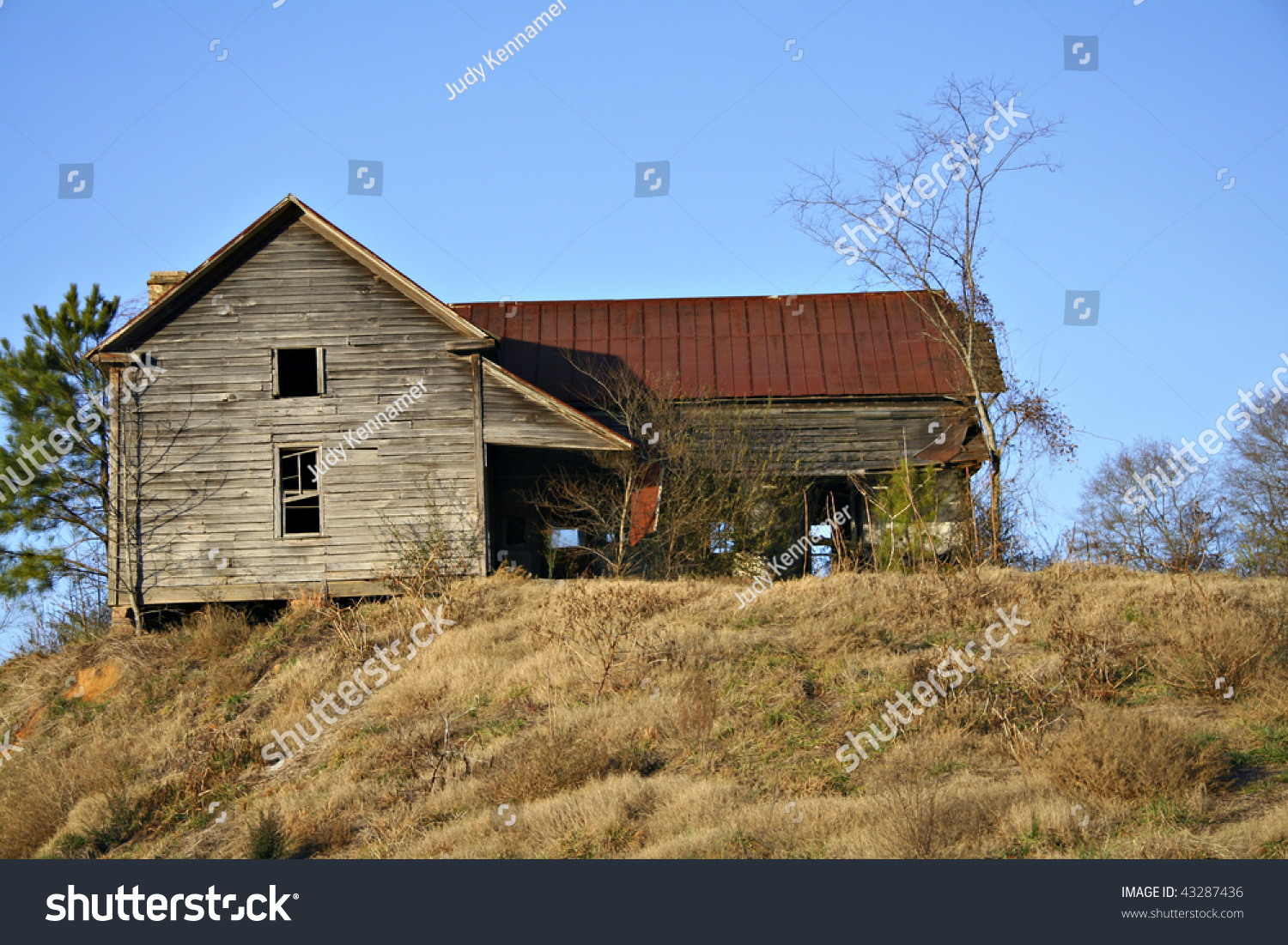 Old Wooden House With Rusted Tin Roof Sitting On Hillside