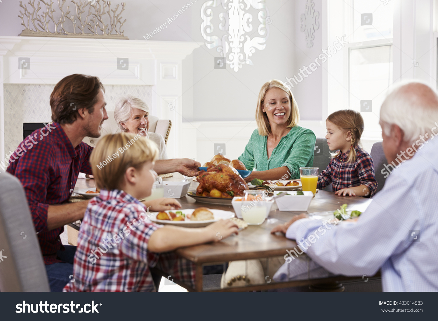 extended family group sit around table stock photo 433014583 shutterstock. Black Bedroom Furniture Sets. Home Design Ideas