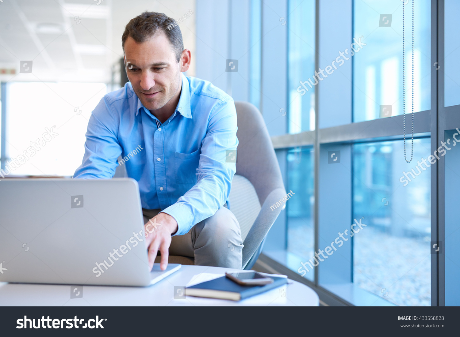bright modern office space with large windows preview save to a lightbox bright modern office space