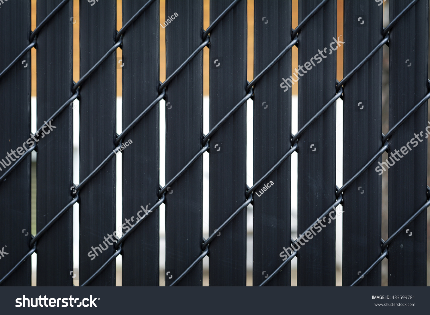 Black metallic fence chain link privacy stock photo