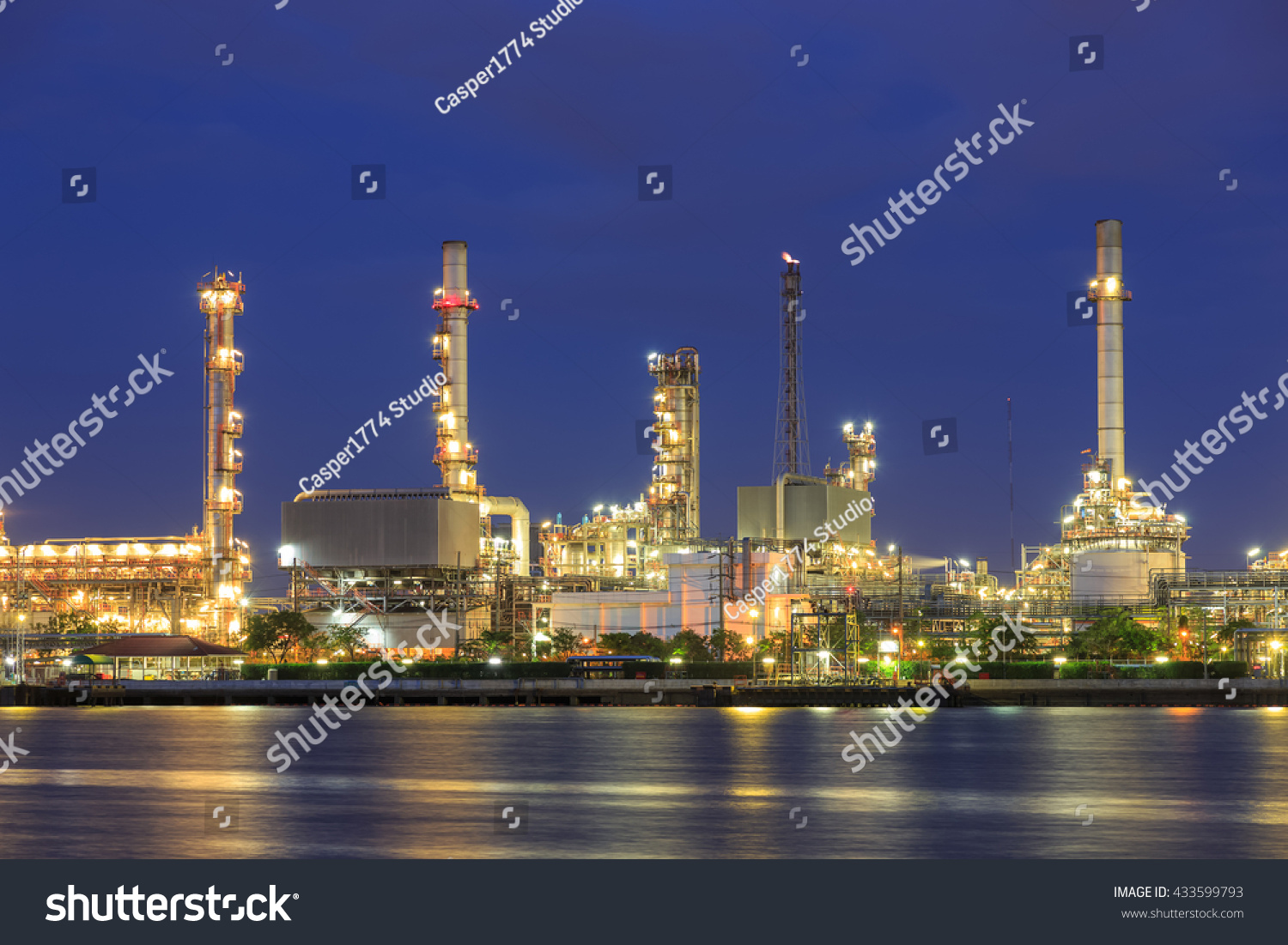 oil refinery plant with water reflection light, at night | EZ Canvas