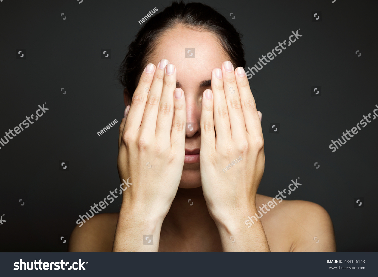 covering face with hands portrait young woman covering half her stock photo 164