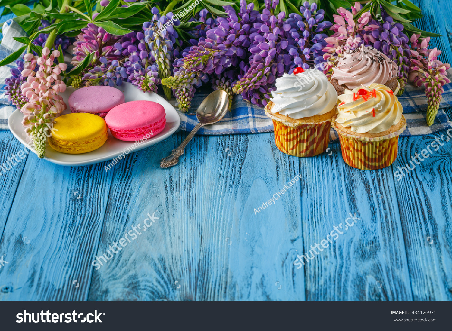 Beautiful flowers on wooden background floral stock photo edit now beautiful flowers on wooden background floral background flower border with cupcakes izmirmasajfo