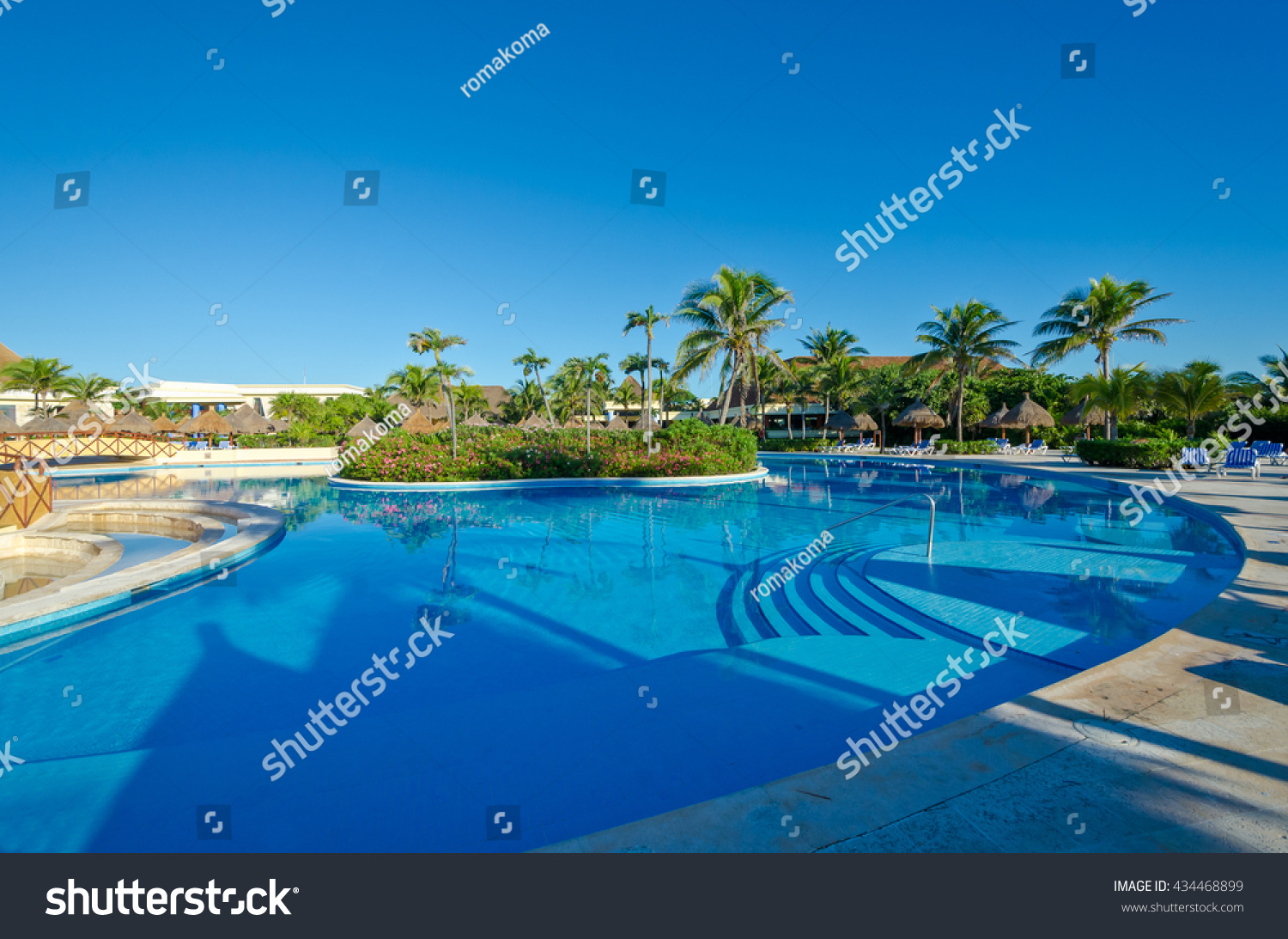 Swimming pool with deep blue sky and dark blue water at the luxury Caribbean,  tropical