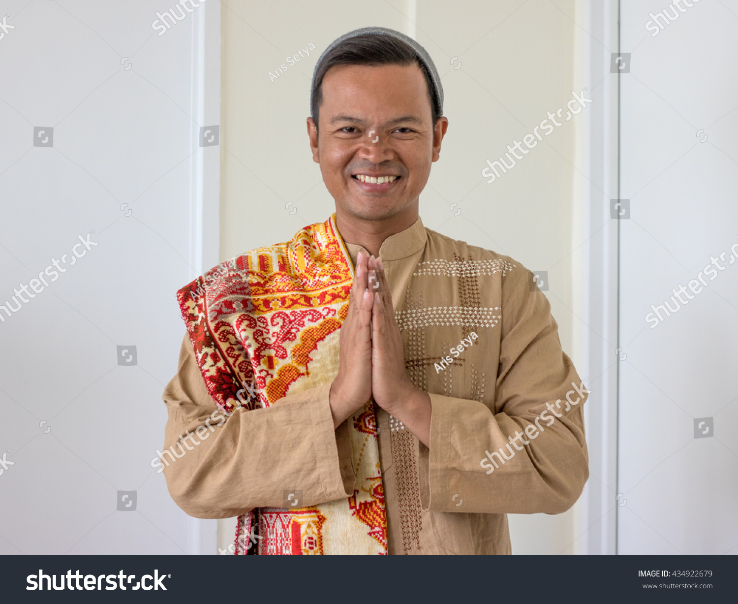 Asian Muslim Man Welcoming Guests Greeting Stock Photo Edit Now