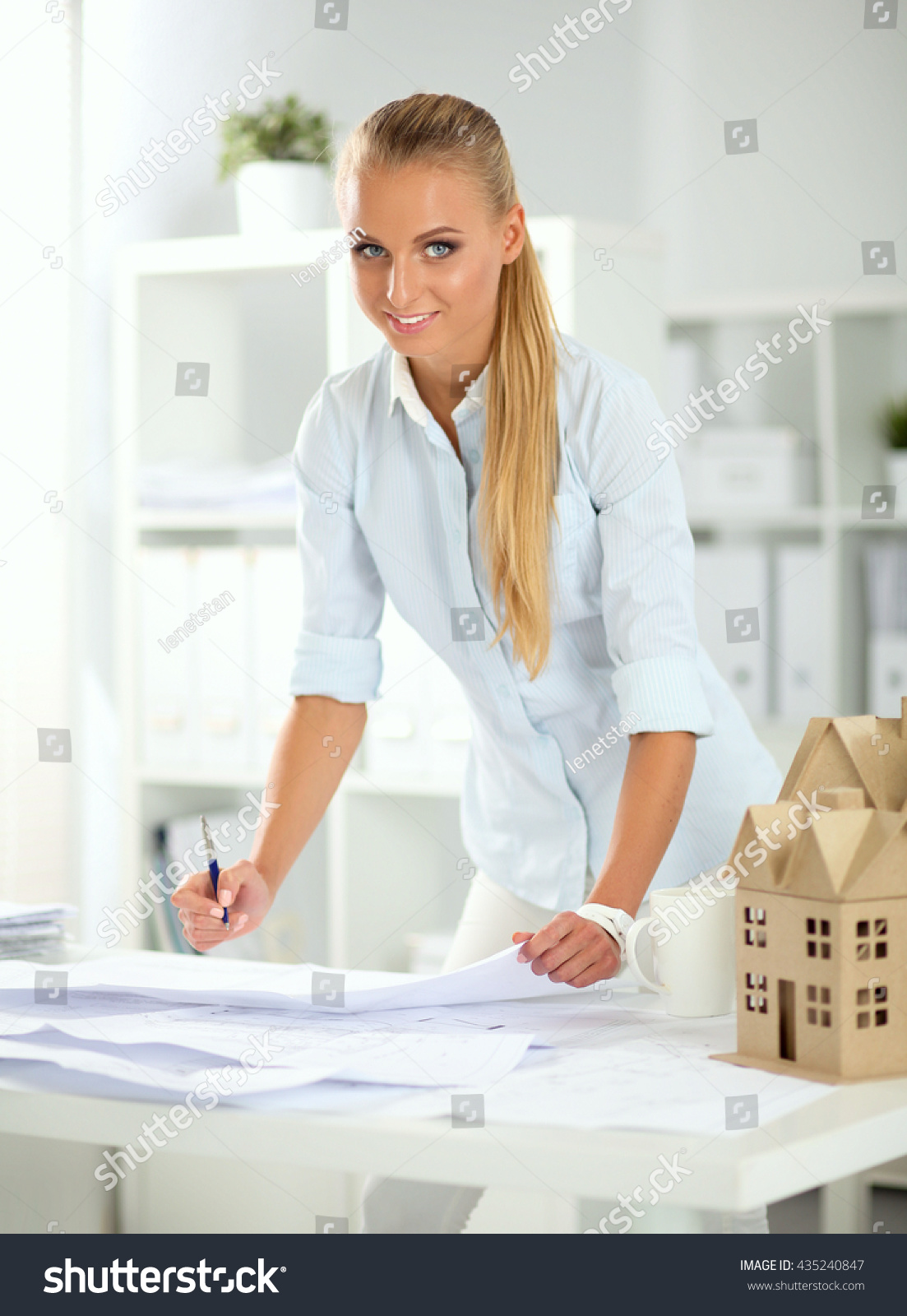 blueprints at desk in office preview save to a lightbox blueprints office desk preview save