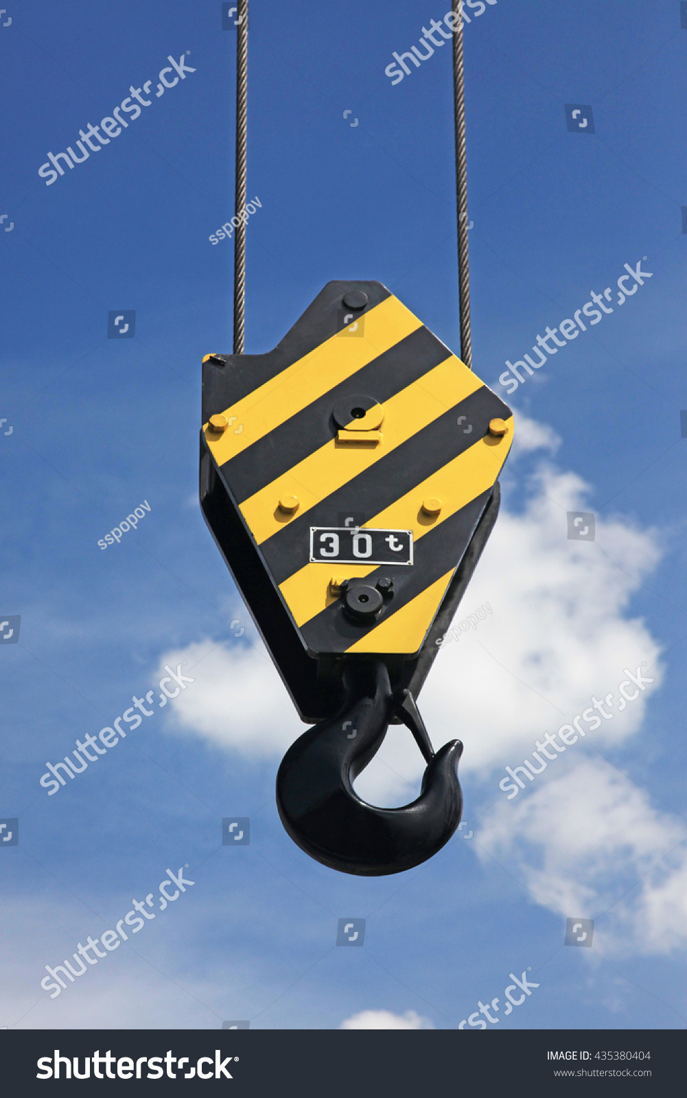 Crane hook yellow black stripes hanging stock photo 435380404 crane hook with yellow and black stripes hanging blue sky in background biocorpaavc Image collections