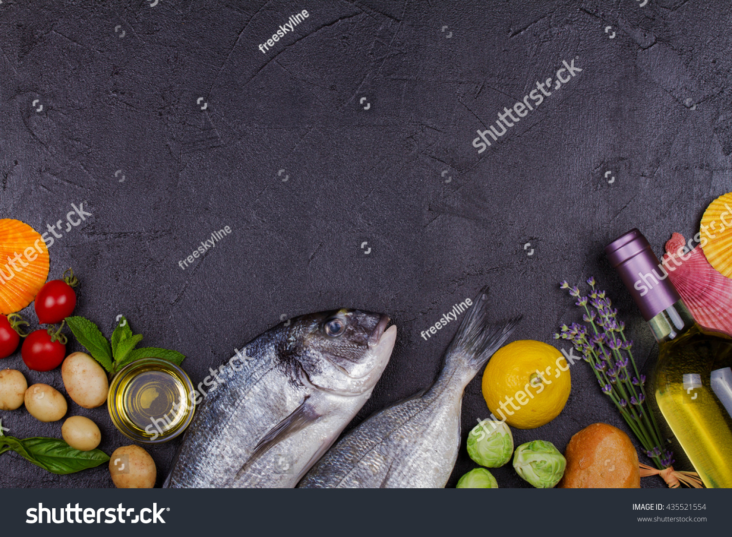 Raw fresh dorado fish brussels sprouts stock photo for Best wine with fish