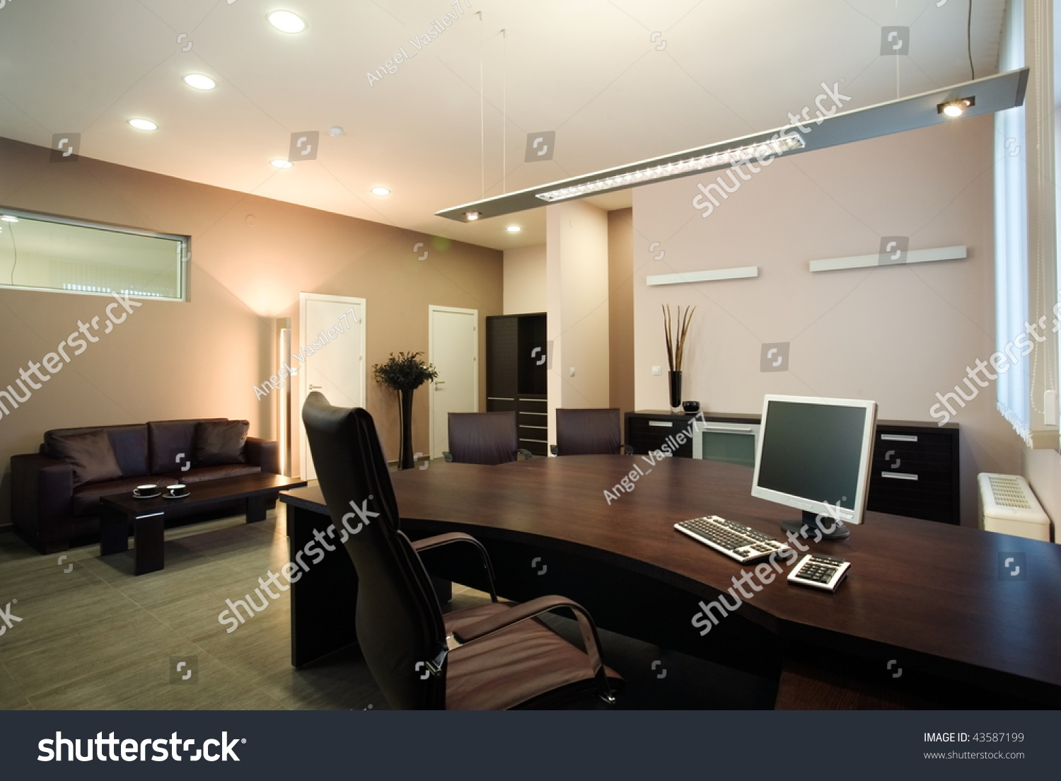 Beautiful and modern office manager interior design stock for Beautiful modern office design