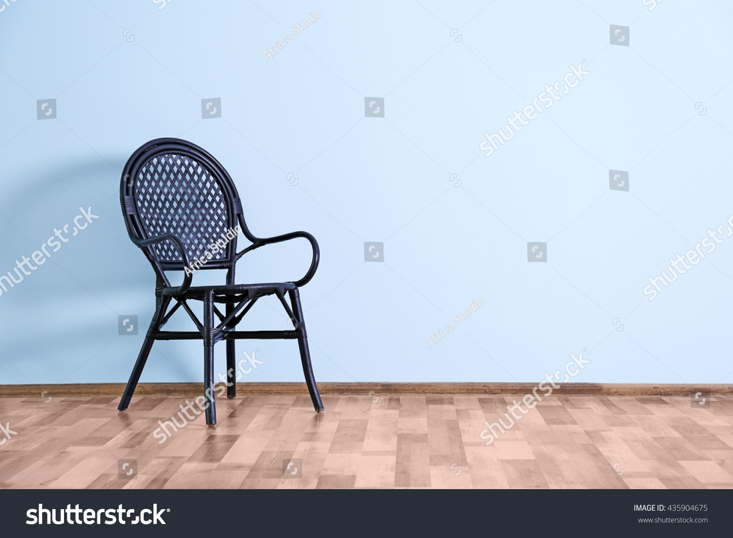 Empty Room With Chair On Blue Wall Background