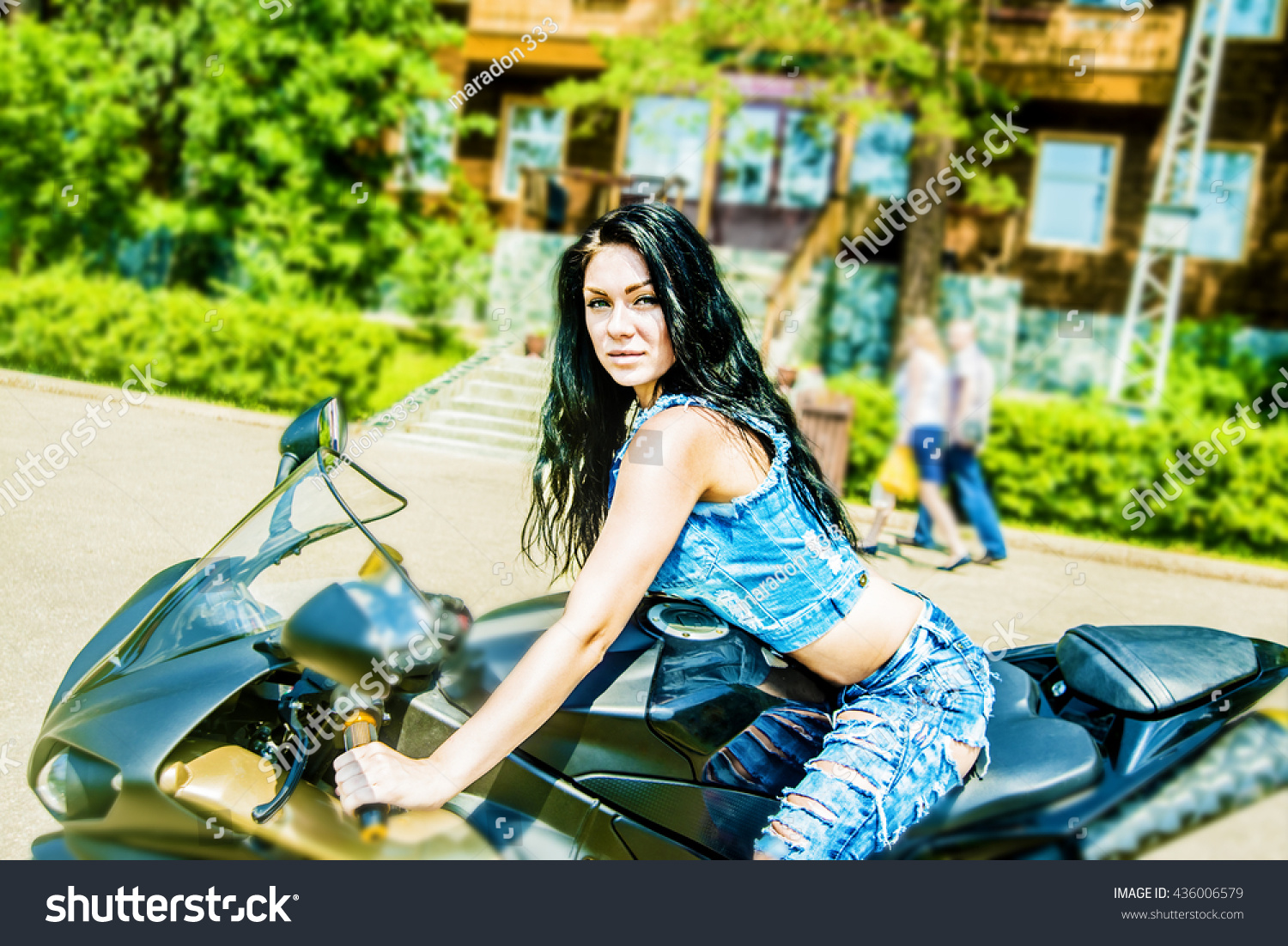Portrait of beautiful brunette woman sit on black sports motorcycle. Very  hot sexy young girl 691656f33a243