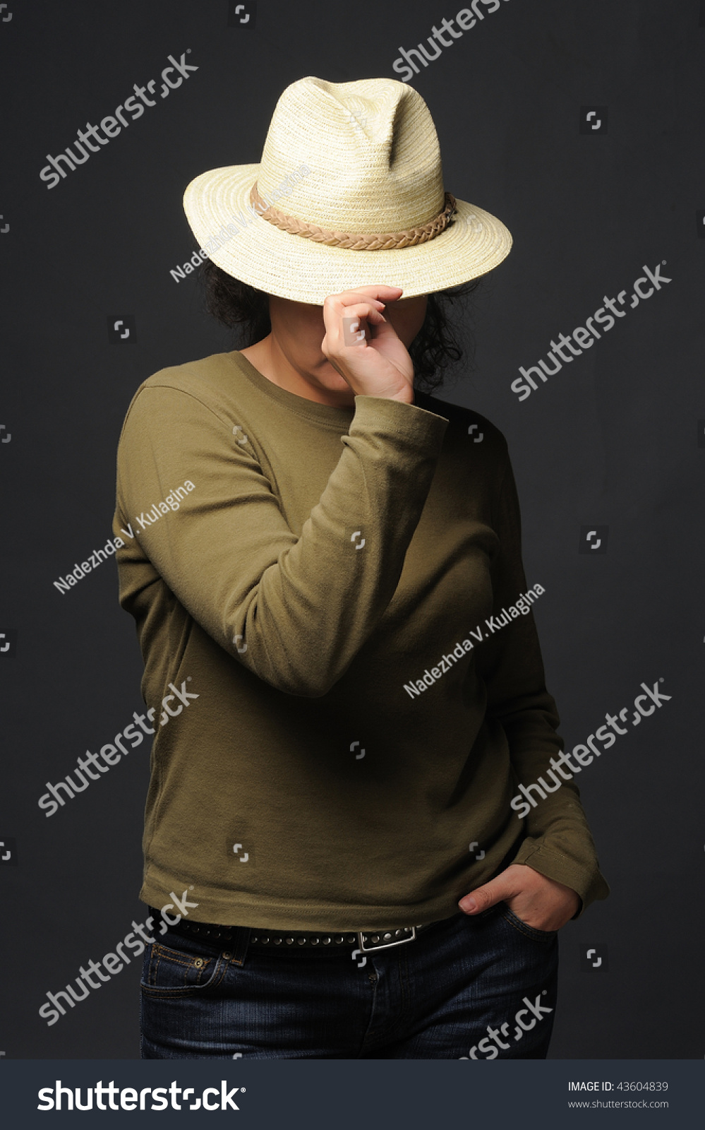 6735dce7718f2 Young boy wearing a cowboy hat isolated on black