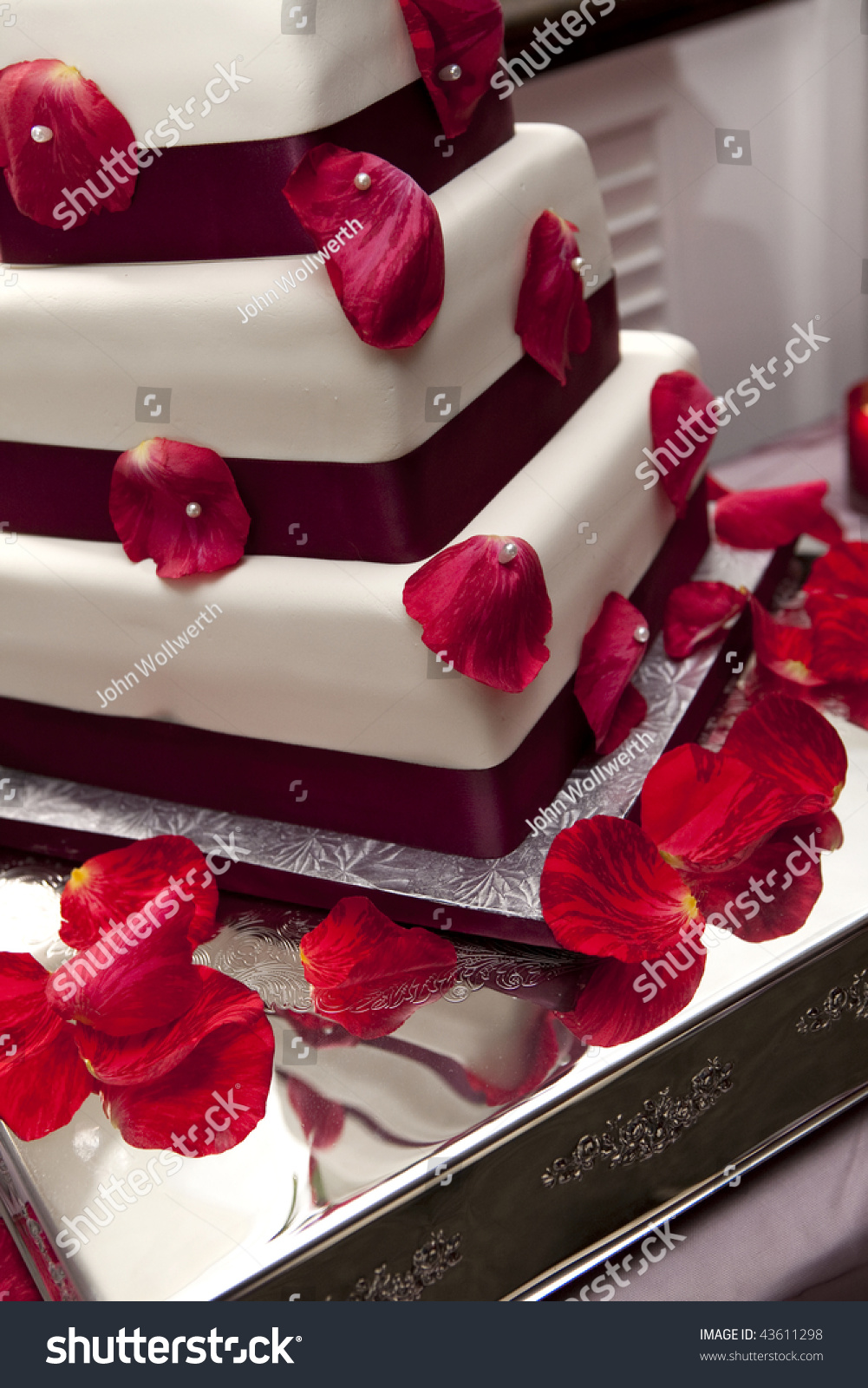 detail shot of wedding cake with roses stock photo 43611298
