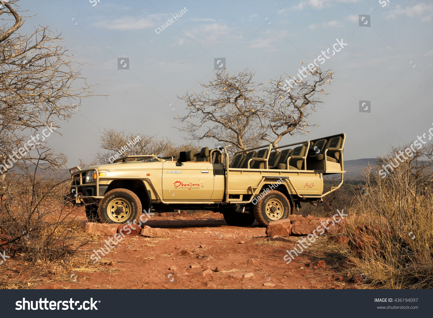 OKONJIMA, NAMIBIA - SEPTEMBER 11, 2015: Toyota Land Cruiser is the safari vehicle of choice for driving tourists around in the African wilderness of Namibia.