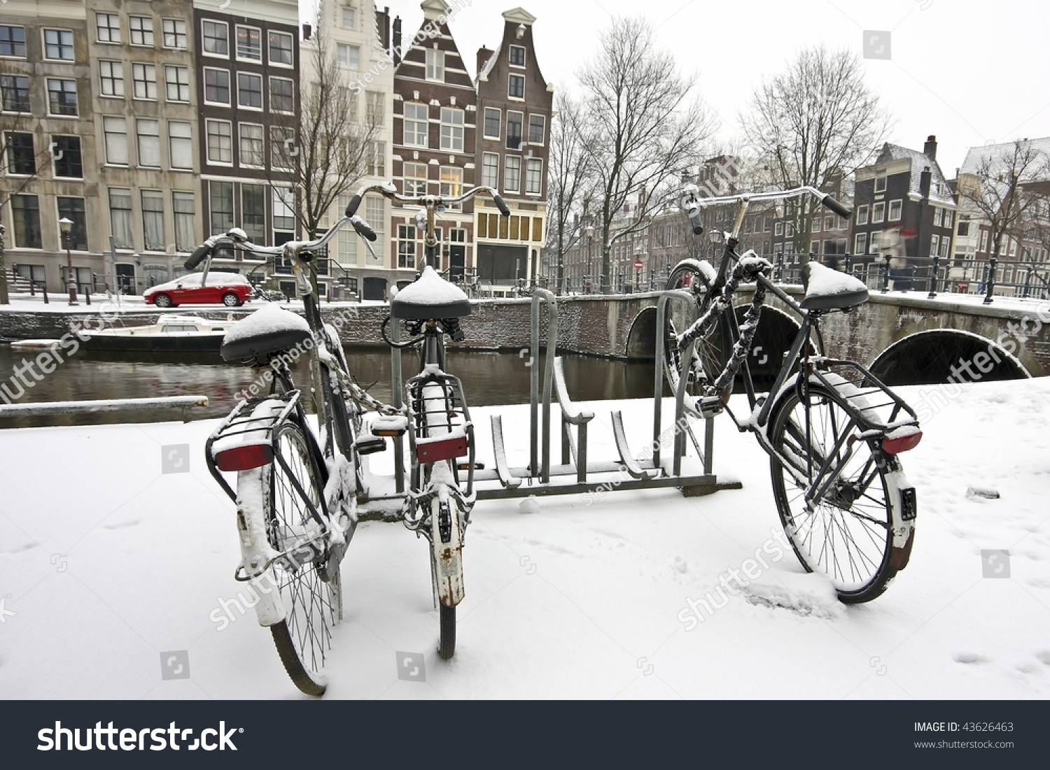 Bikes in the snow in Amsterdam Netherlands in wintertime