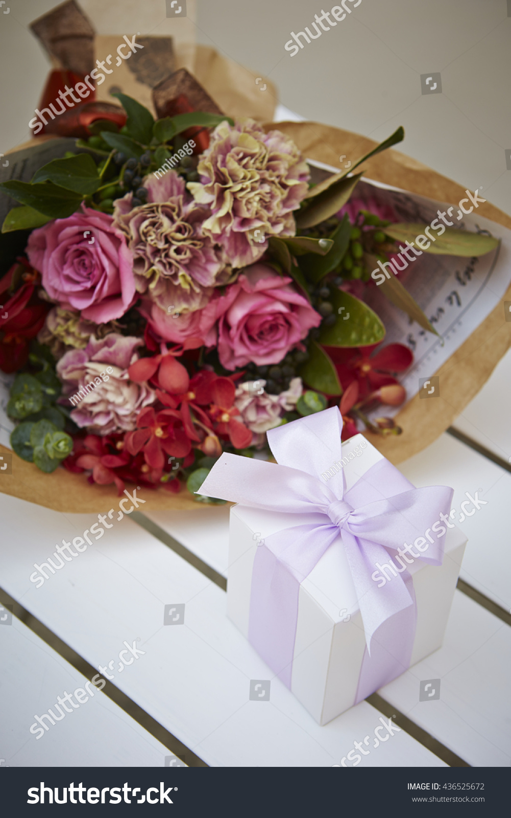 Flower bouquet gift boxes stock photo royalty free 436525672 flower bouquet with gift boxes izmirmasajfo