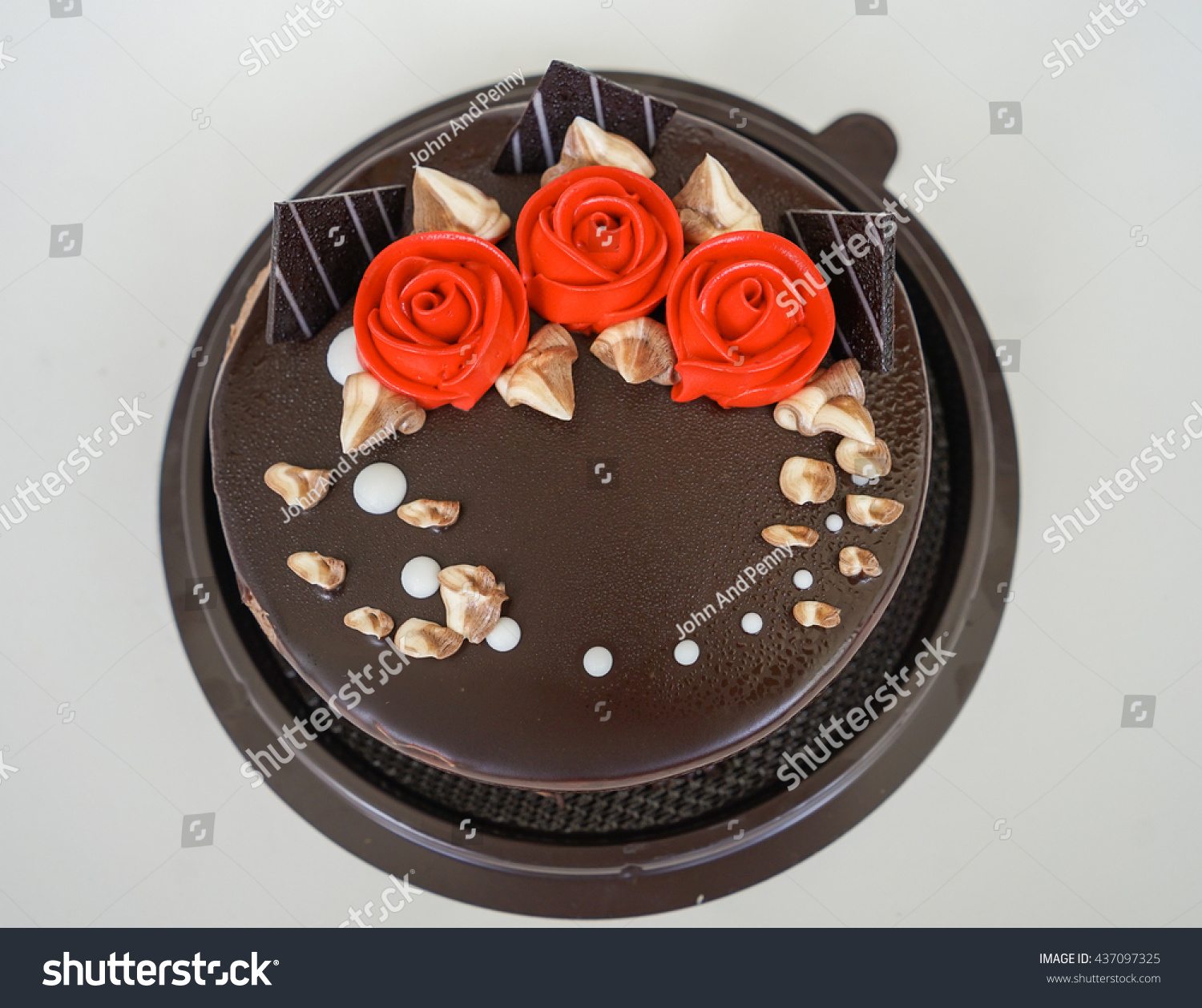 Beautiful chocolate birthday cake edible red stock photo edit now a beautiful chocolate birthday cake with edible red rose flowers izmirmasajfo
