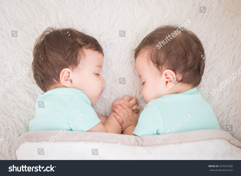 Newborn Beautiful Baby Twins Sleeping Pacifier Stock Photo ...