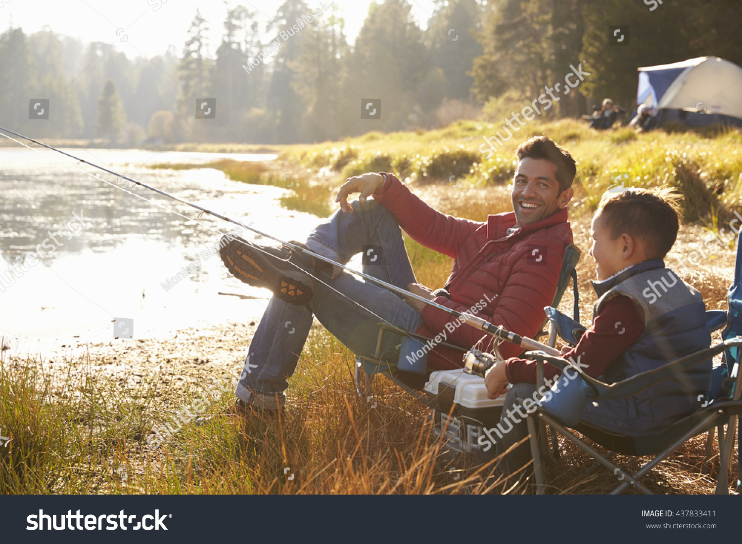 Father son fishing by lake dad stock photo 437833411 for Father son fishing