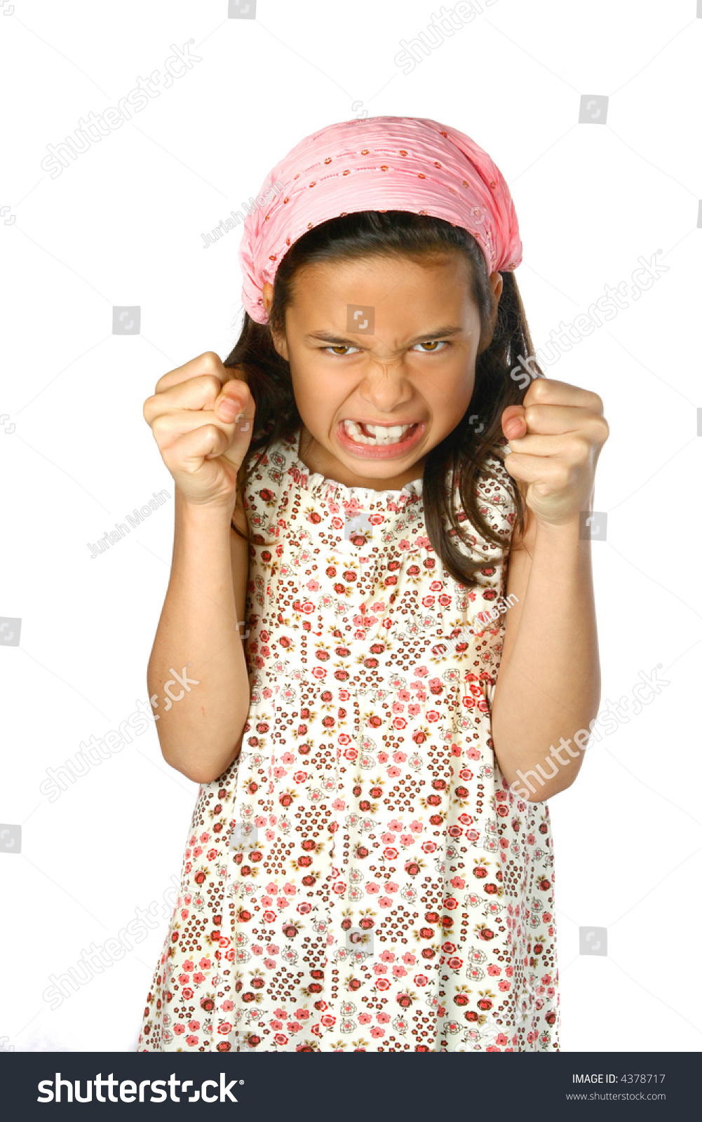 Young girl with both hands in fist showing anger,frustration and  displeasure on her face