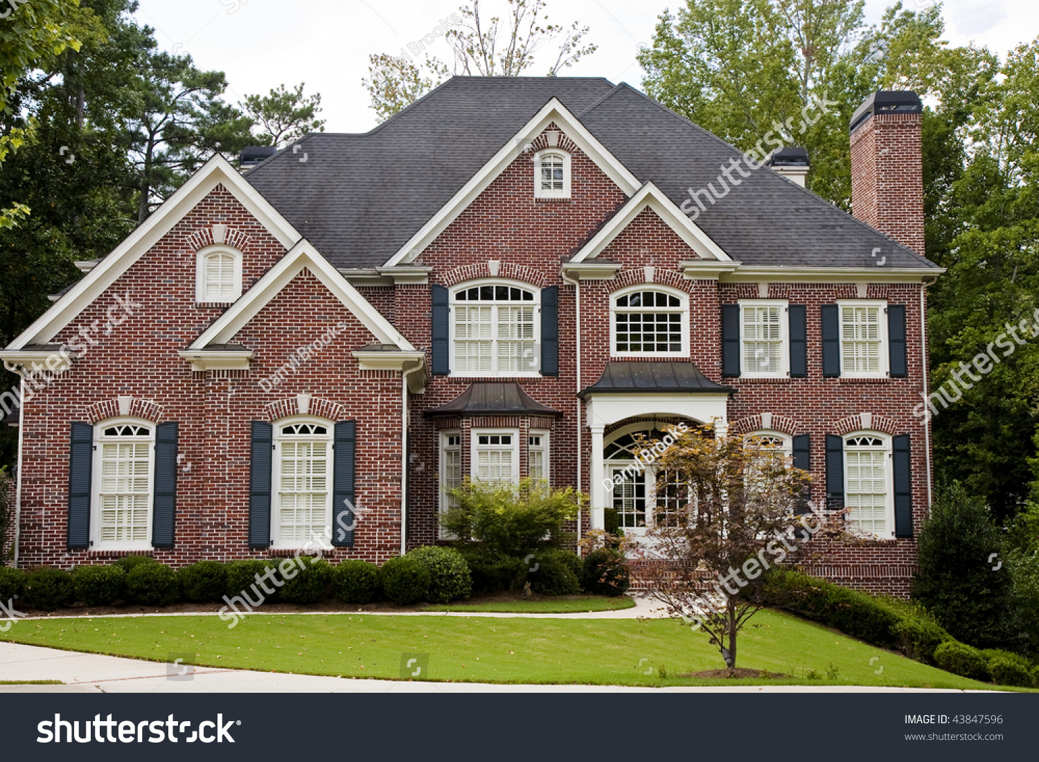 nice brick two story house on stock photo 43847596