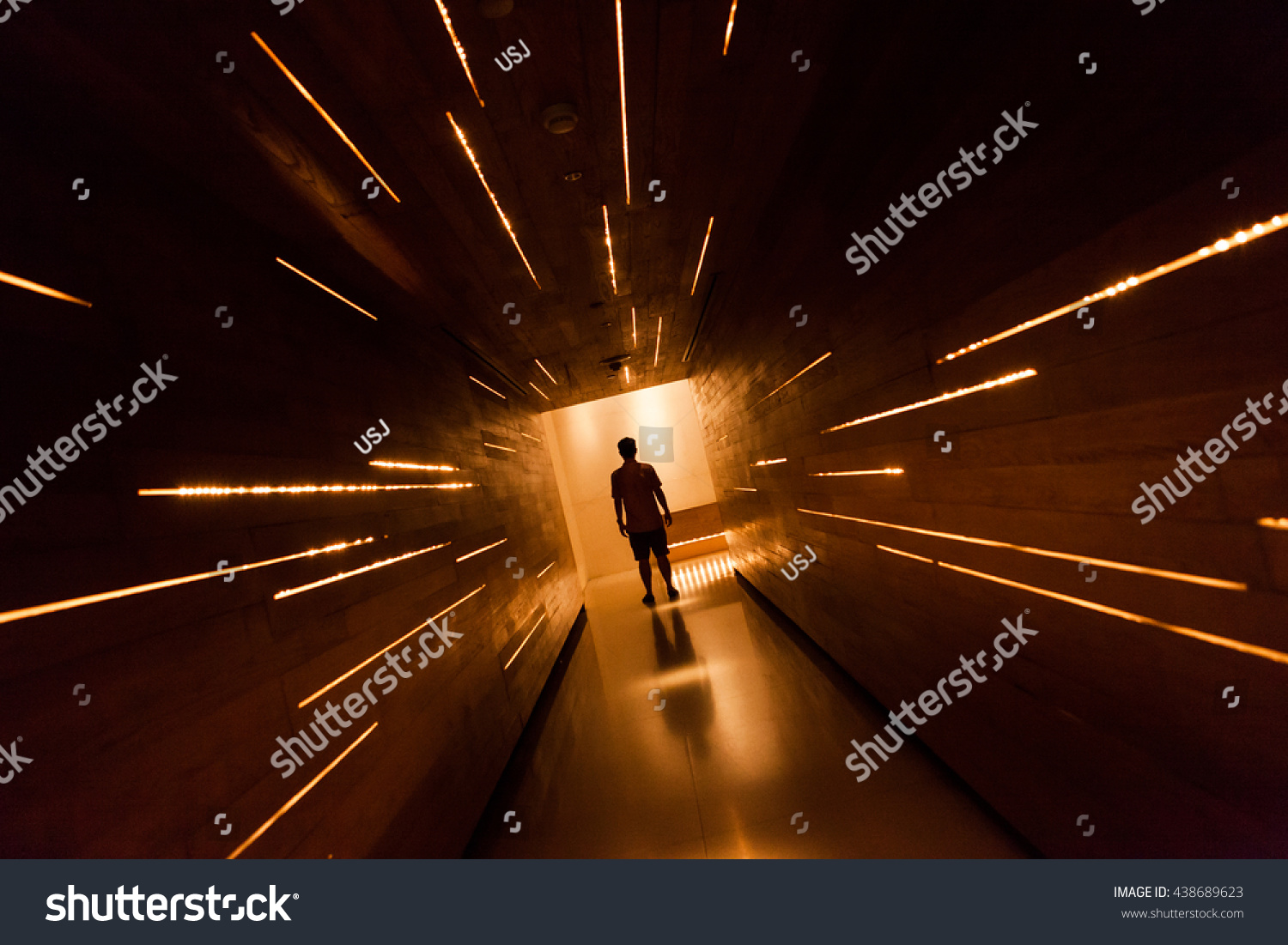 Silhouette human in the center of beautiful corridor design. #438689623