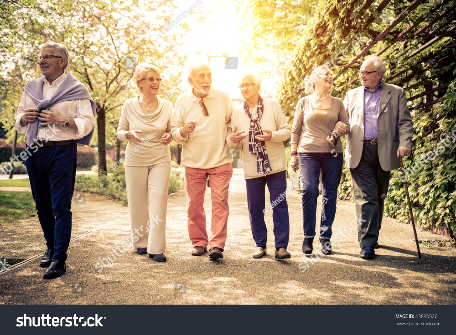 group old people walking outdoor old stock photo (royalty free
