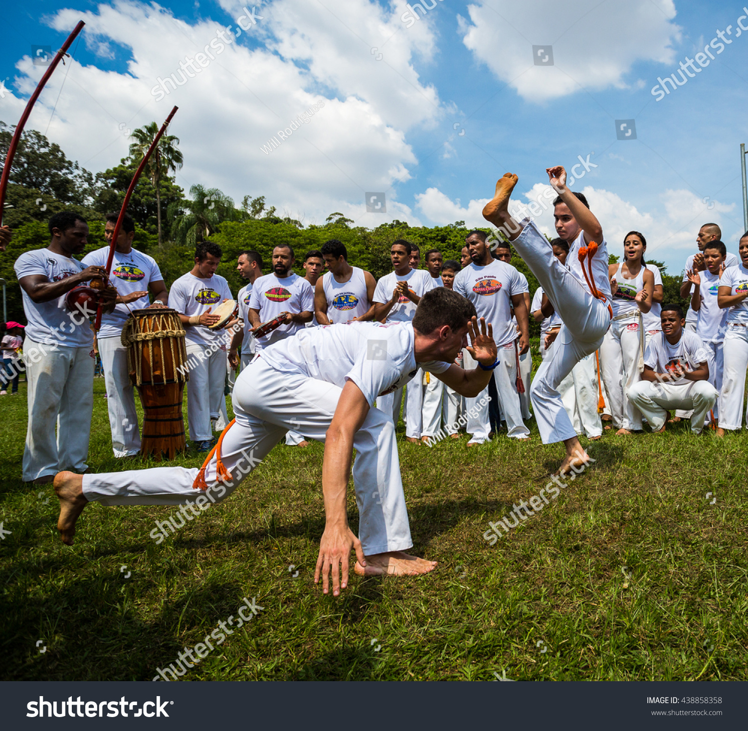 Sao Paulo Brazil 03 April 2016 Group of Brazilian capoeiristas performing at the Ibirapuera Park in Sao Paulo Brazil