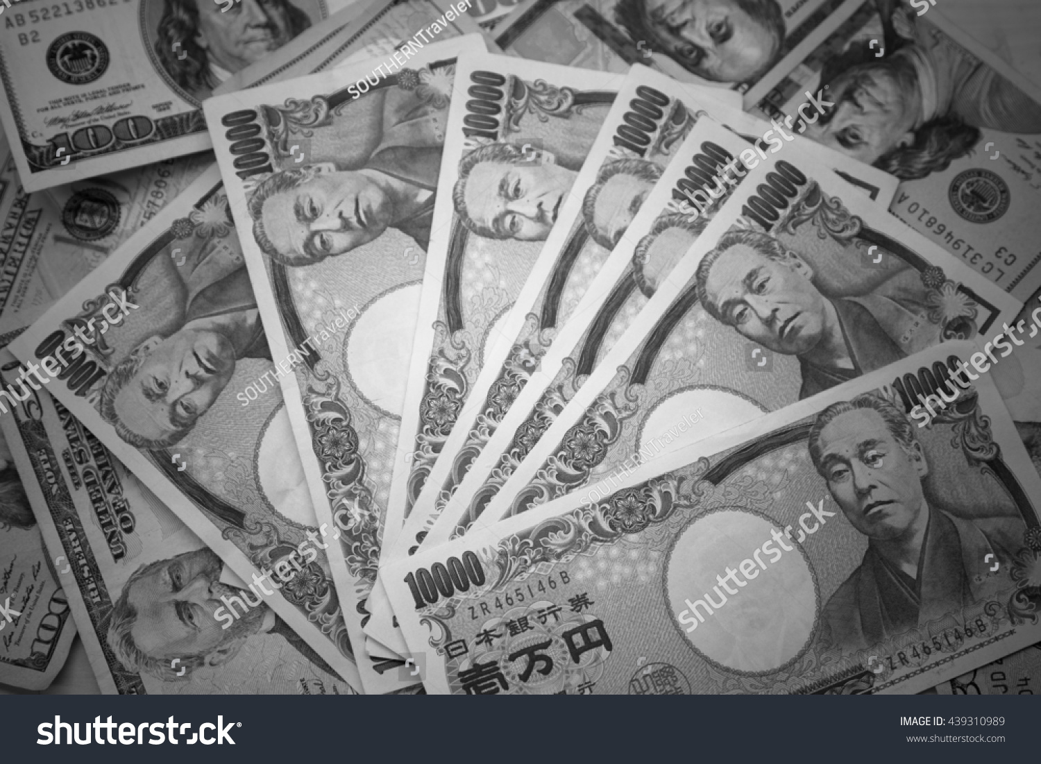 10 000 japanese yen and 100 dollar banknote with black and white color filter money background