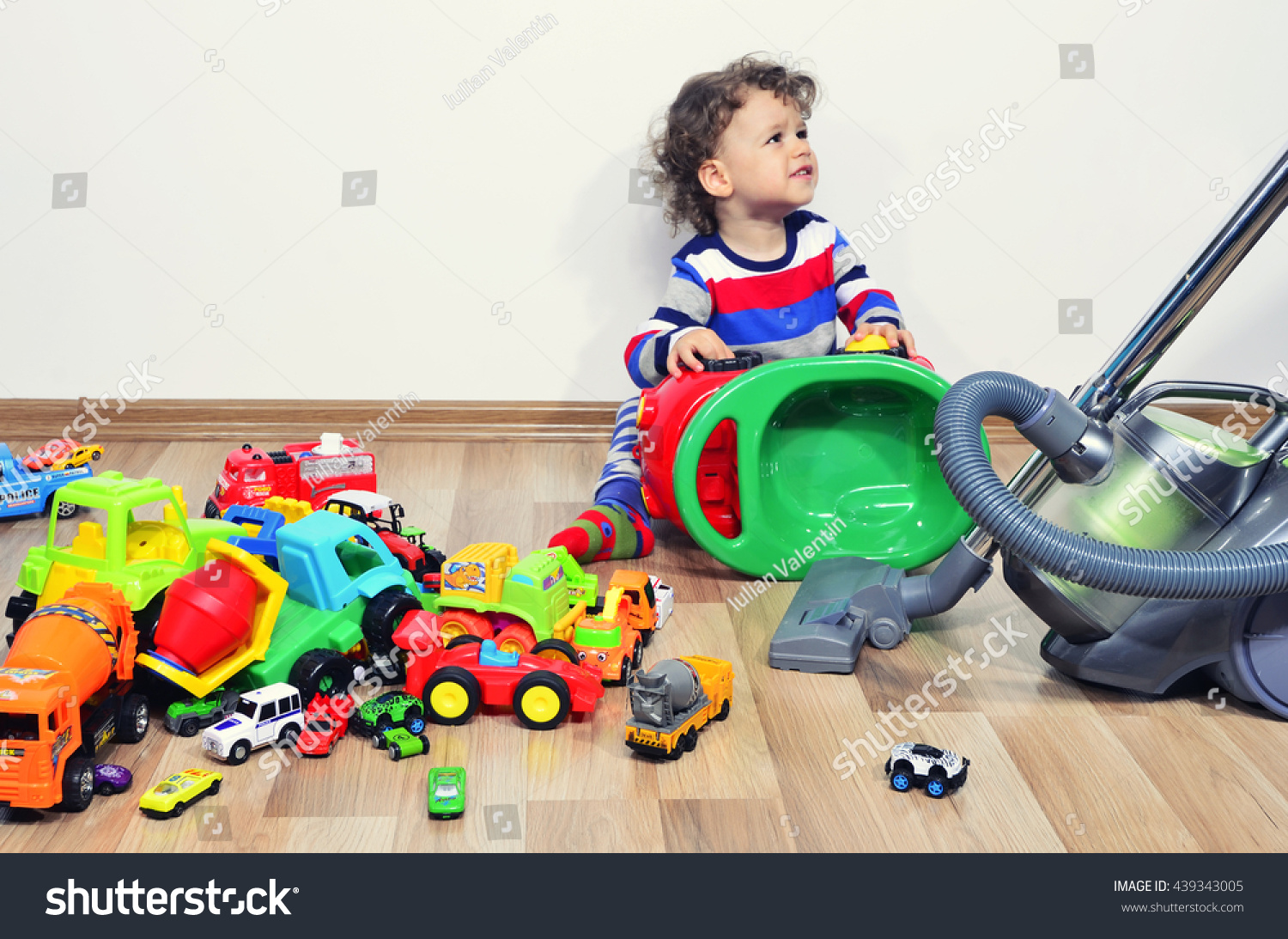 Cleaning Messy Room mother cleaning messy room full toys stock photo 439343005