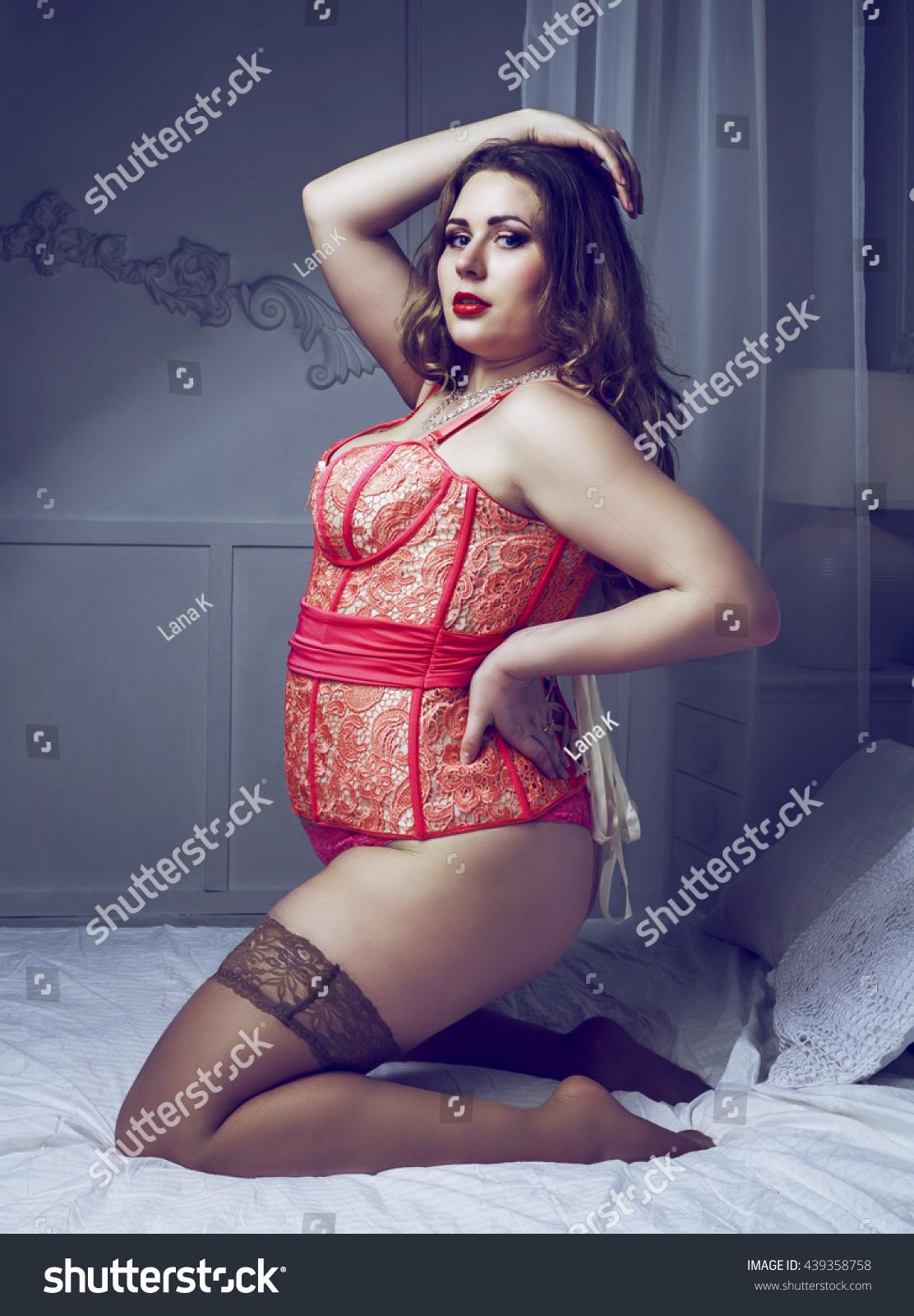 sexy plus size model wearing corset stock photo 439358758
