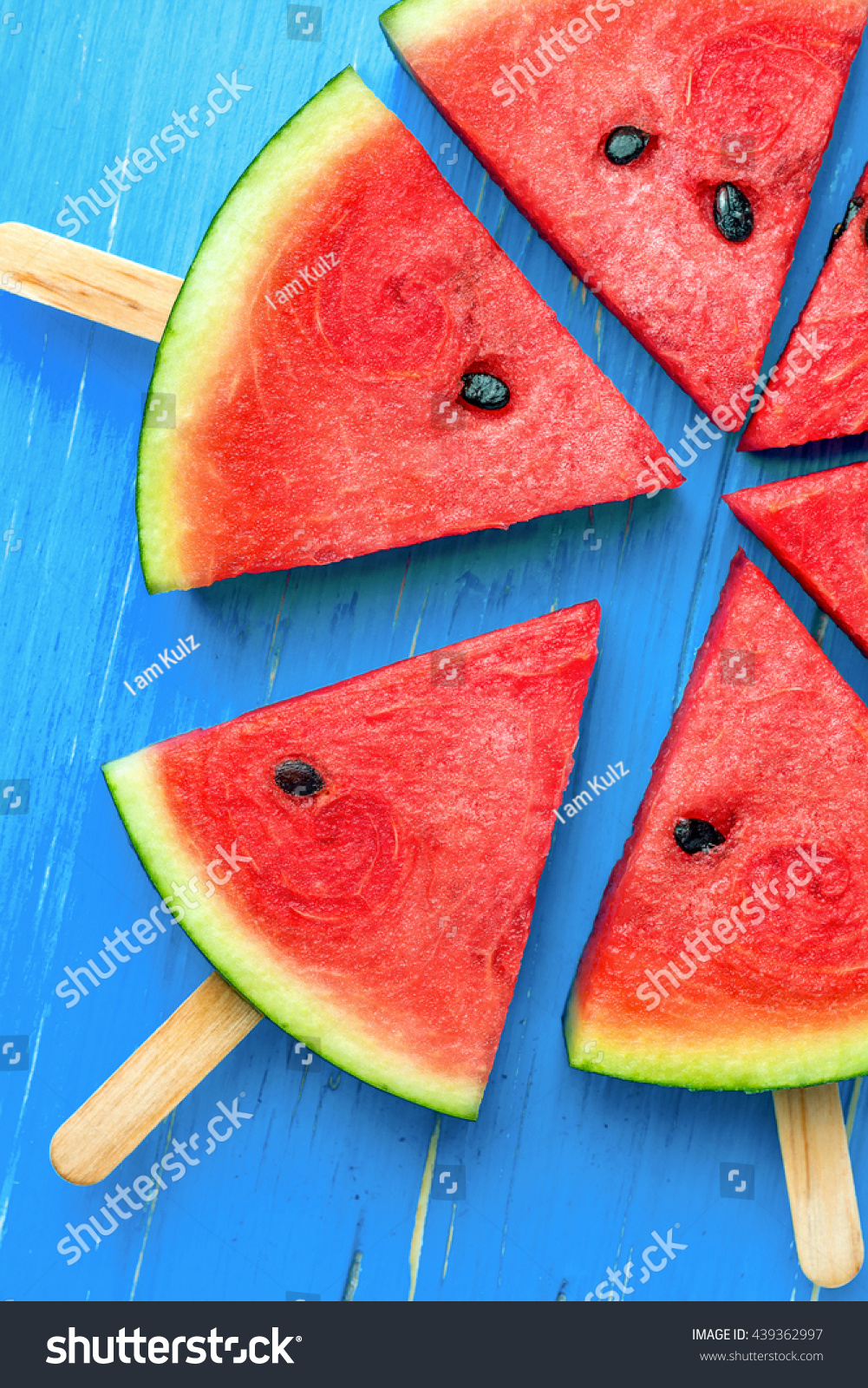 Watermelon Slice Popsicles On Blue Rustic Stock Photo