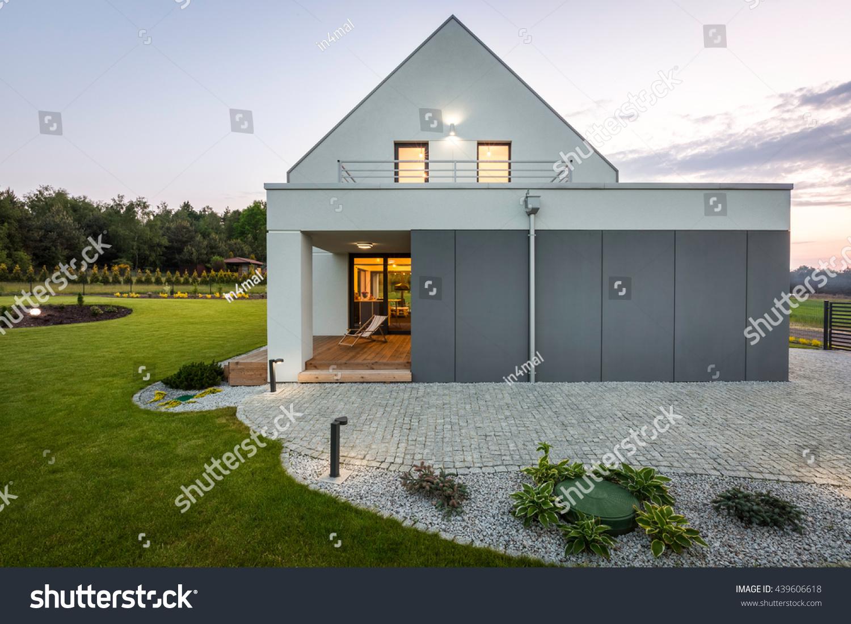Modern villa with garage stone driveway backyard and decorative outdoor lighting