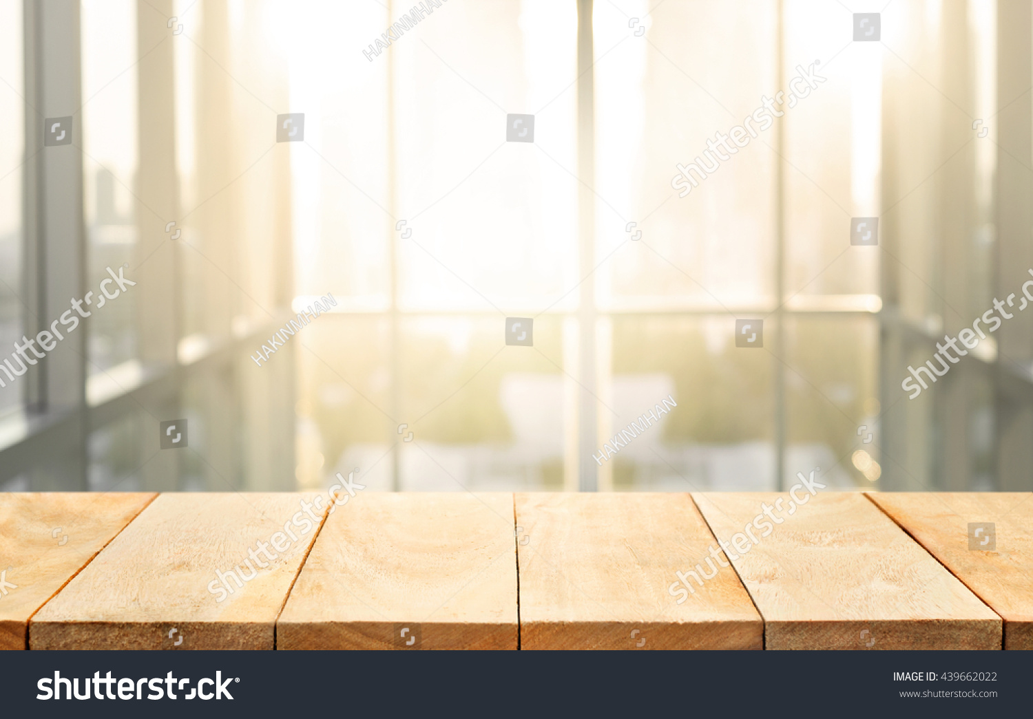Superbe Wood Table Top With Blur Sunlight In Glass Window Of Building Background.For  Montage Product