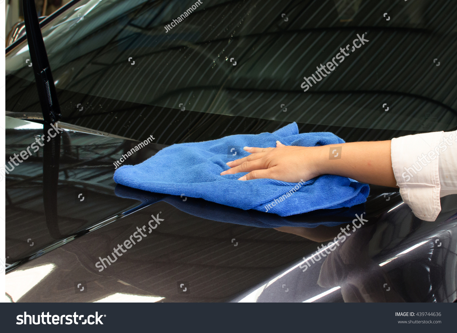hand with microfiber cloth wipe car surface stock photo 439744636 shutterstock. Black Bedroom Furniture Sets. Home Design Ideas
