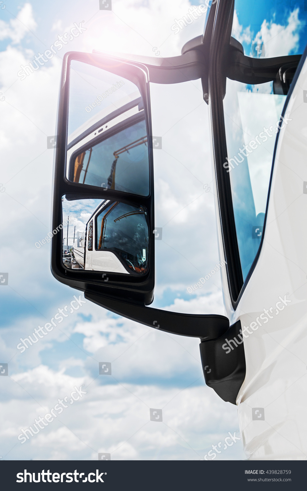 rear-view mirror on the truck sky reflected in rearview mirror focus on rear-view mirror